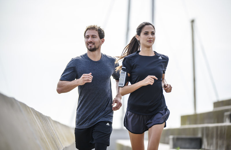 A man and a woman running