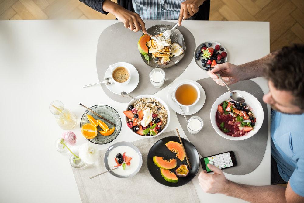 Two people eating breakfast