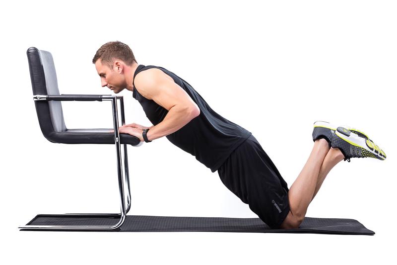 Man doing incline knee-push-up