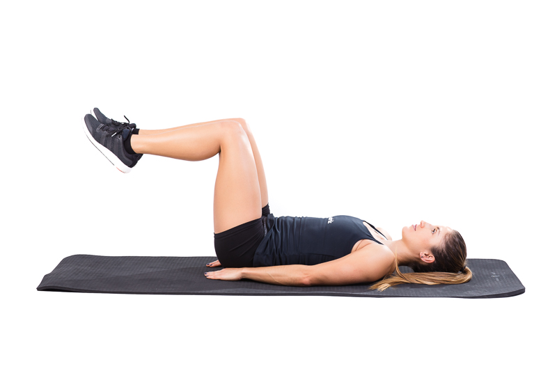 girl doing lying bent knee raises