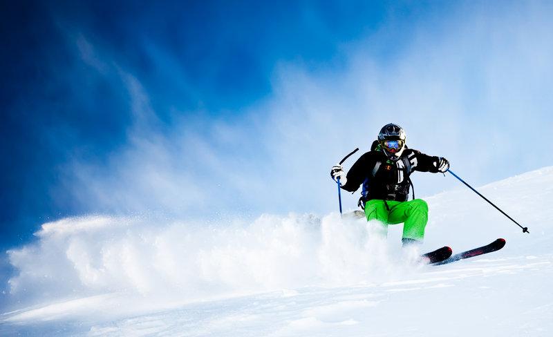 Man skiing down in powder