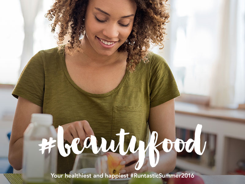 Beautiful young woman preparing a healthy meal.