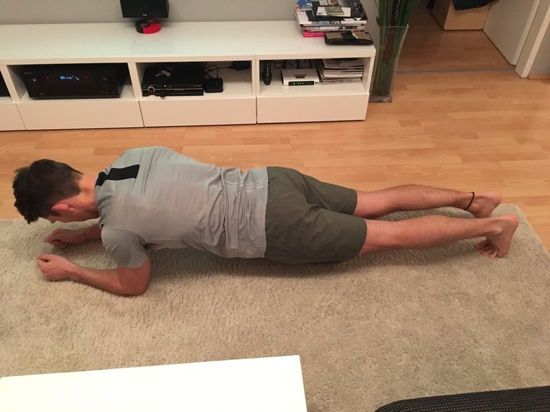 Florian Gschwandtner CEO of Runtastic doing a plank.