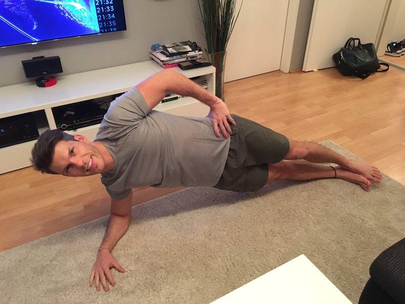 Florian Gschwandtner CEO of Runtastic doing a side plank.