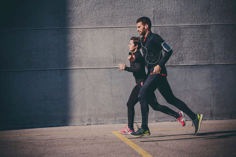 young couple running together