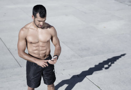 Man shirtless training outside