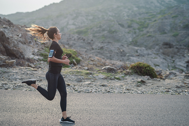 A woman running outside