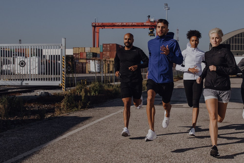 group of people running outdoors