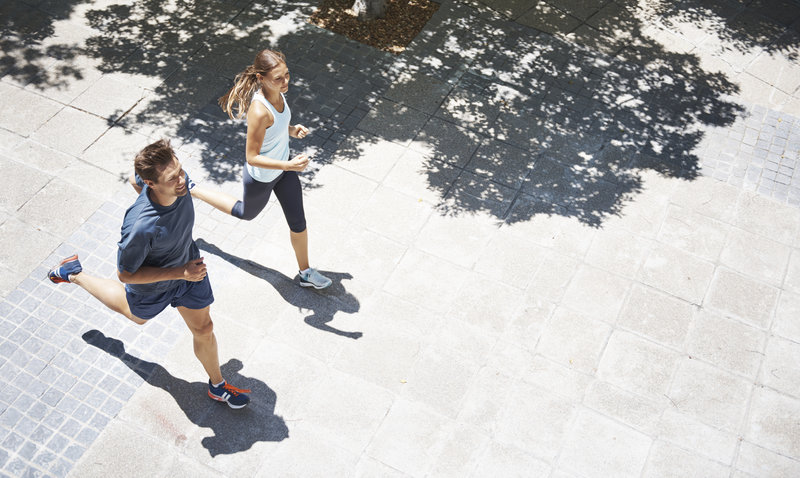 Young couple is running together.