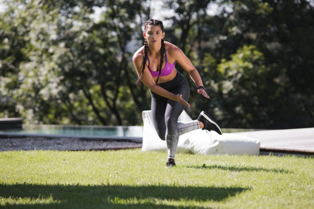 Woman doing leg exercises outdoor