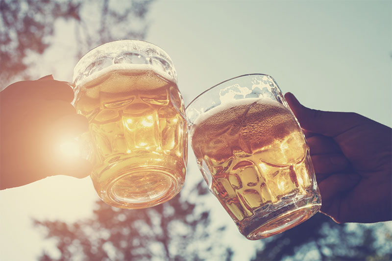 Close up of two glasses of beer.