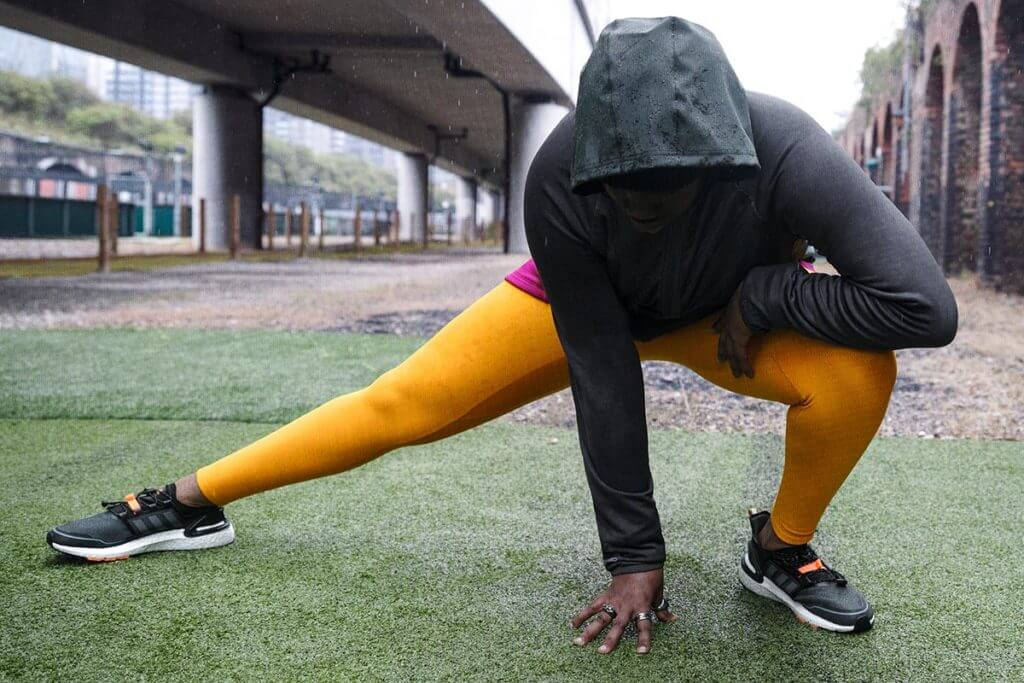 Woman doing stretching outdoors in the winter time