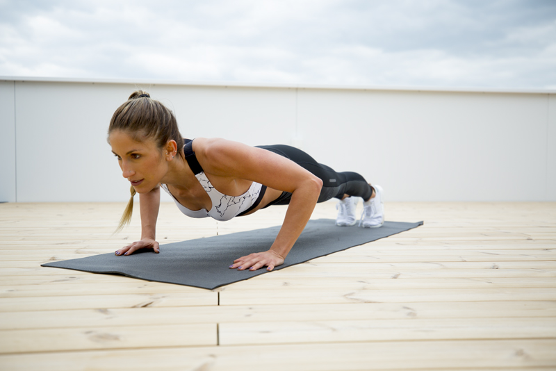 Woman is doing 2-2-2 push ups