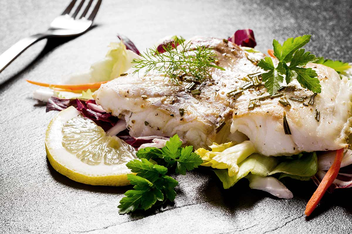 Pescado con limón y verduras