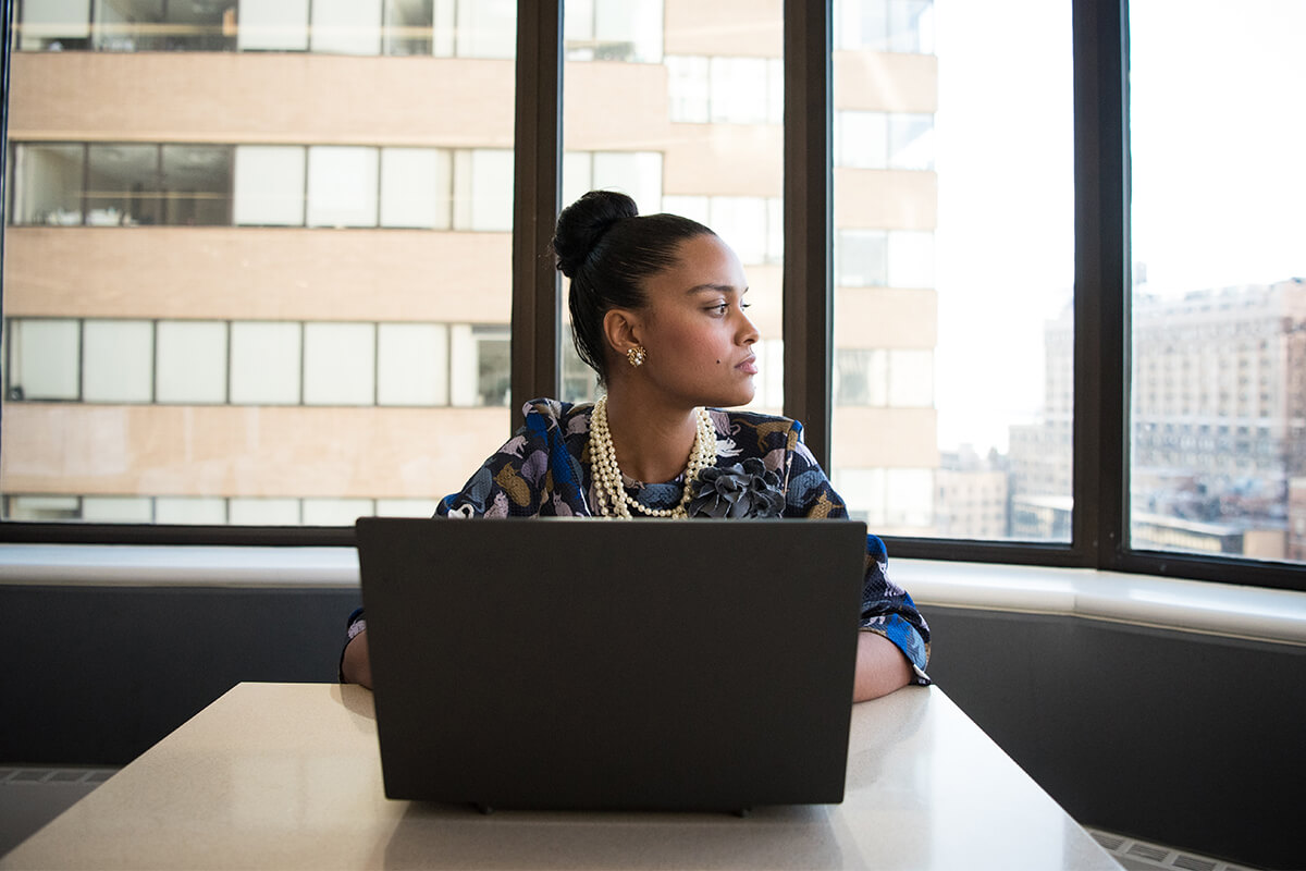 A young lady sitting in front of her laptop
