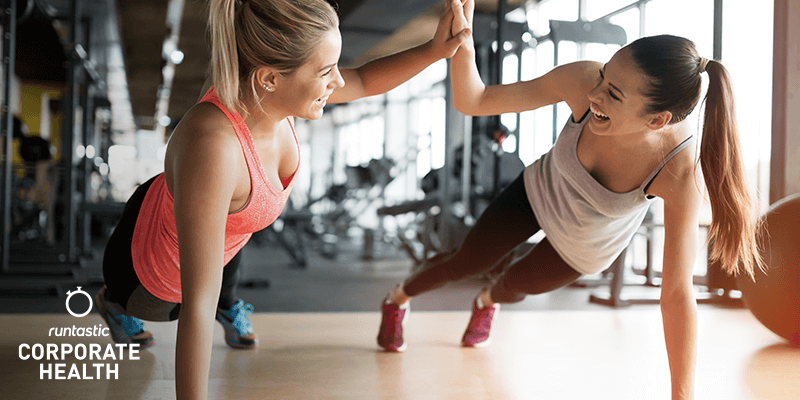 Two young women working out together