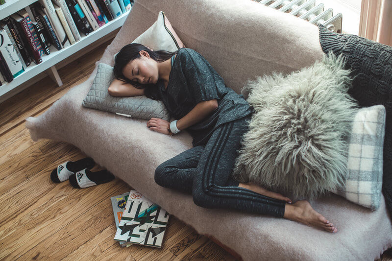 Young woman sleeping on the sofa