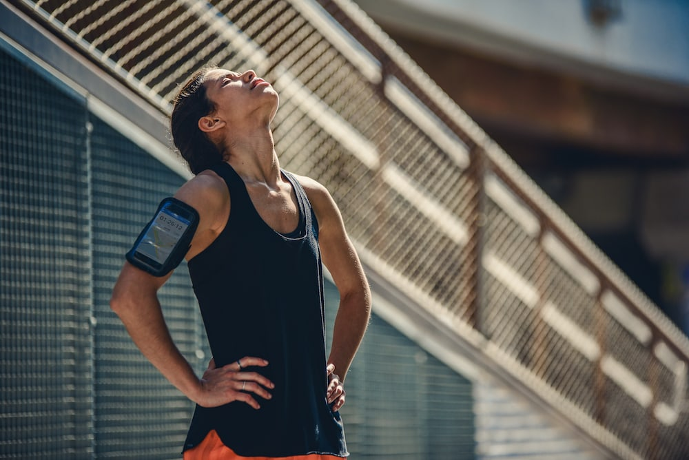 woman in sport clothes enjoys the sun outdoors