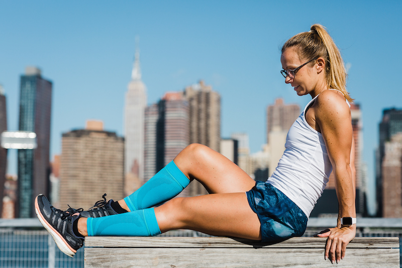 a young lady in adidas clothes in front of New York's skyline