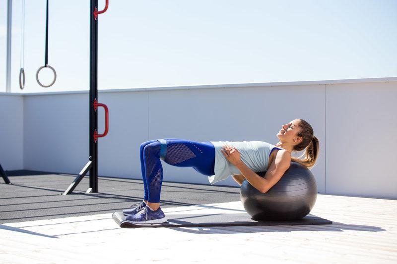 Woman is doing a ball bridge
