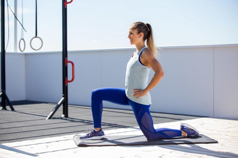 Woman doing a hip flexor stretch