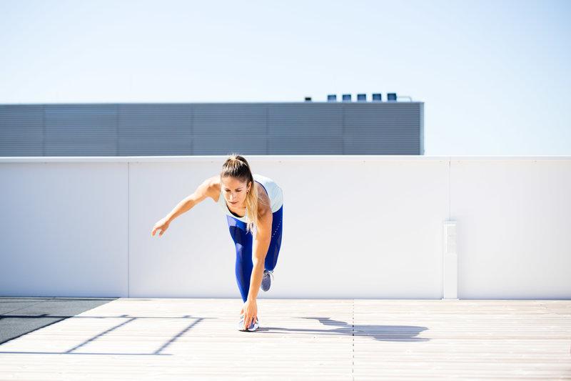 Woman is doing a single leg balance reach