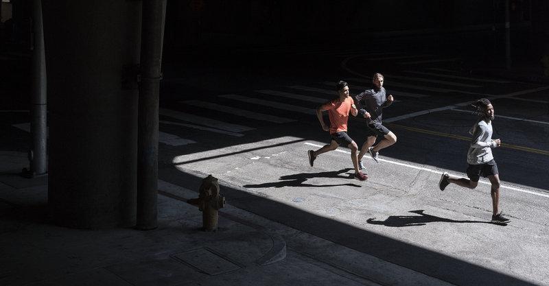 3 men running outside