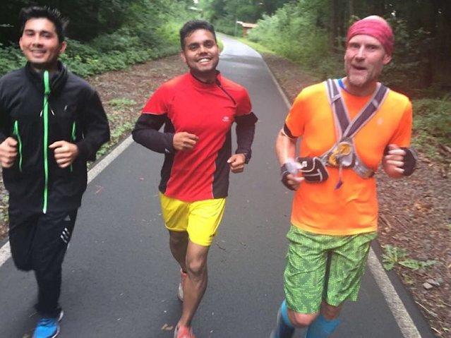 Three men are running on the street