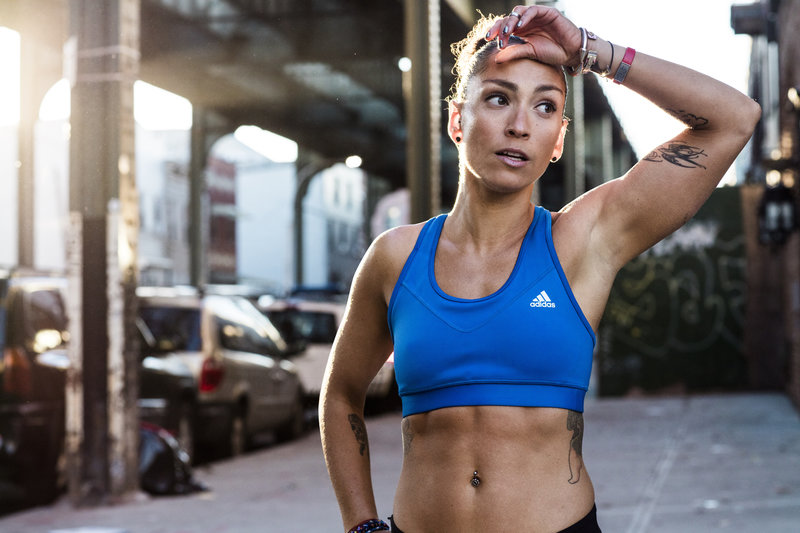 Woman looks exhausted after her run in the city