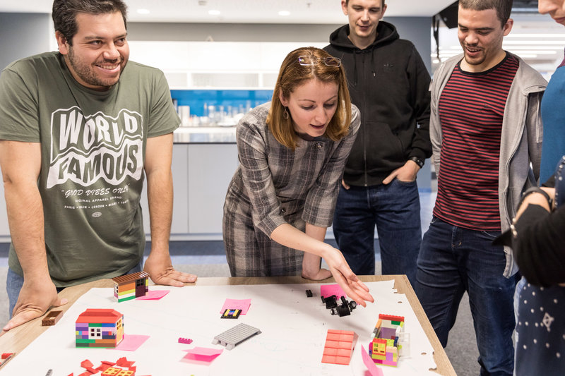 People in the office playing lego