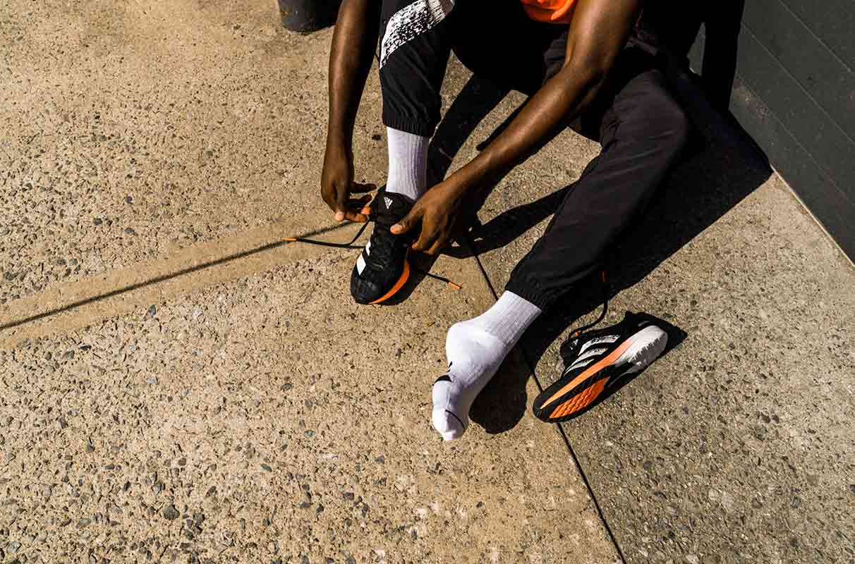 Man tying shoes before the race