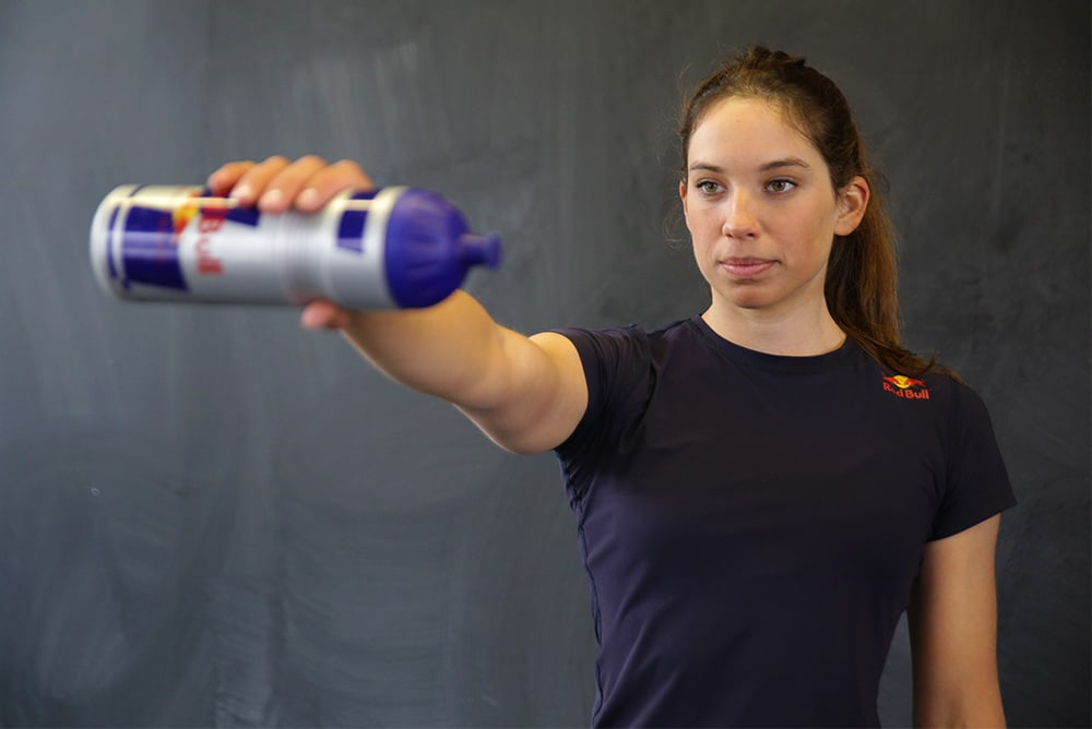 Woman doing an exercise with a workout bottle