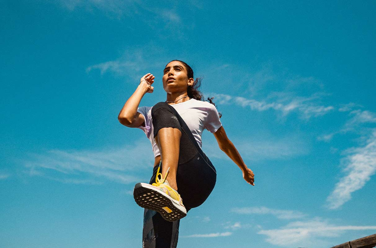 A young woman is doing warm-up exercises before running on an empty stomach