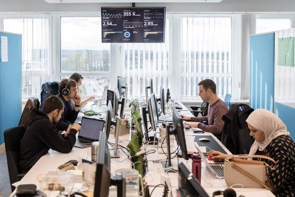 Runtastic employees working the office