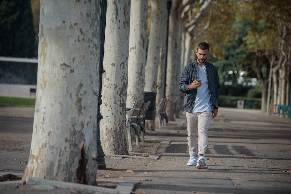 Young man walking outdoors
