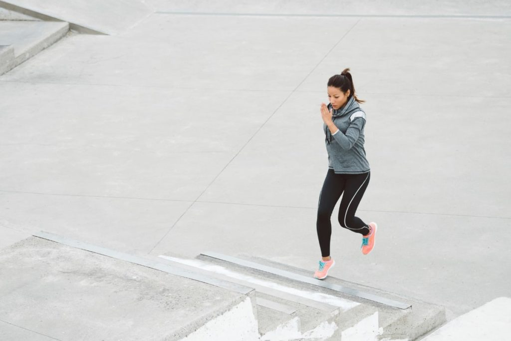 woman running stairs