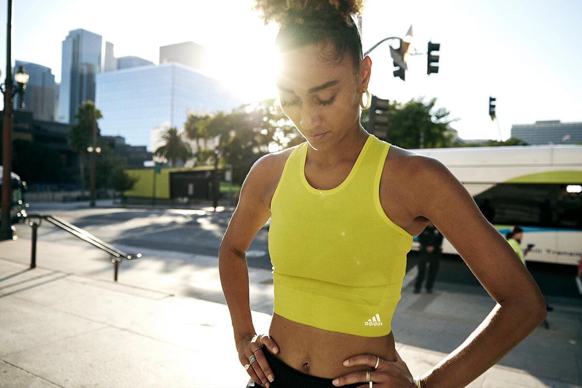 Female runner pauses during a run