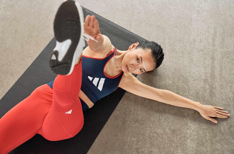 woman identifying her muscle asymmetry