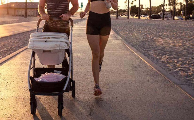 couple running with a stroller