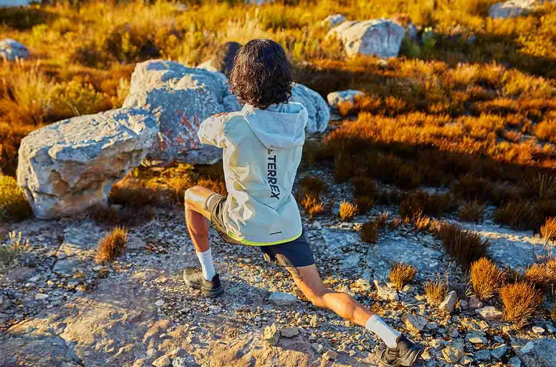 Man stretching on a trail run
